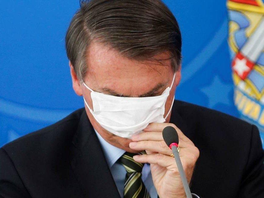 Presidente Jair Bolsonaro com máscara durante coletiva Foto: ADRIANO MACHADO / REUTERS
